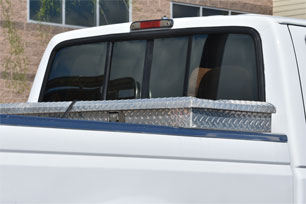 Back of pickup truck with metal storage