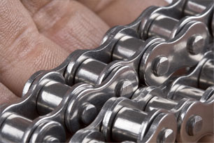 Close-up of bicycle chain in a hand
