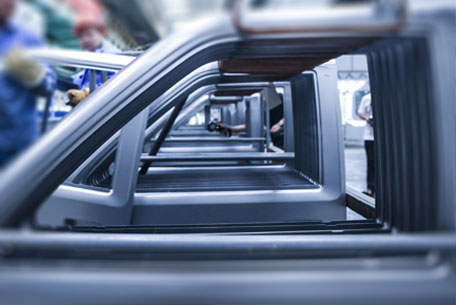 Row of car doors being manufactured