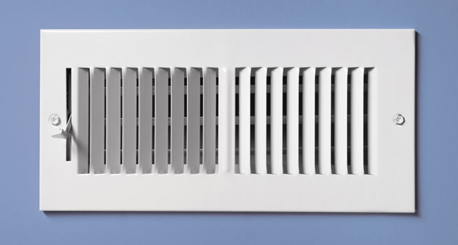 Heat Vent Register on a Blue Wall