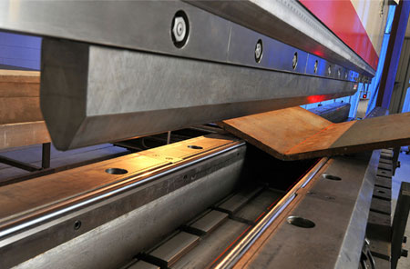 close up of thick material bending in press brake